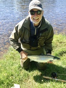 Eric with his first salmon of the season - taken on the River Ness on the fly