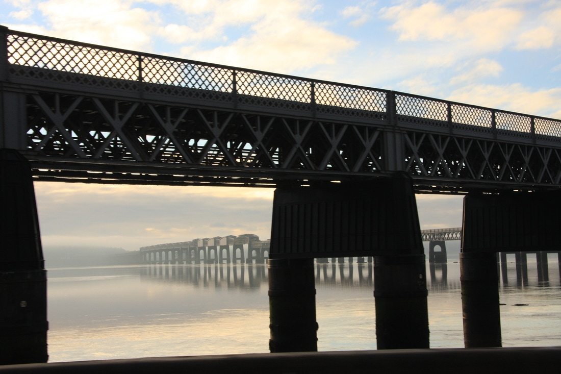 The railway bridge over the River Tay on a very still morning
